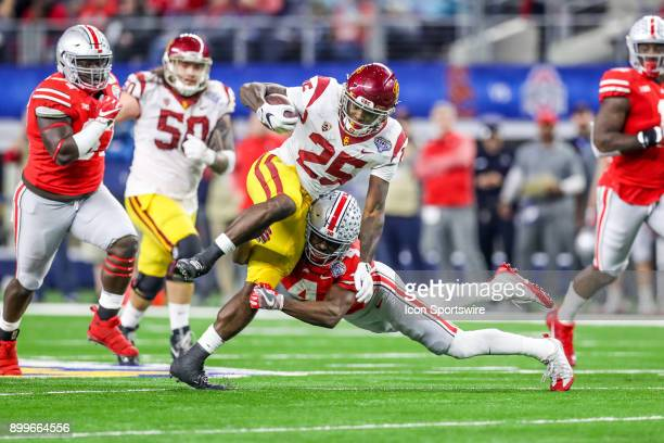 Trojans running back Ronald Jones II runs up the middle during the Goodyear Cotton Bowl Classic between Ohio State and USC on December 29 at ATT...