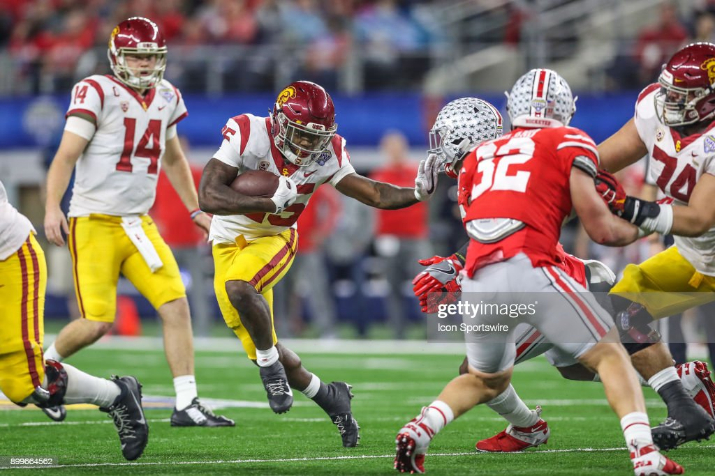 USC Trojans running back Ronald Jones II (25) uses a stiffarm during the Goodyear Cotton Bowl Classic between Ohio State and USC on December 29, 2017, at AT&T Stadium in Arlington, TX.