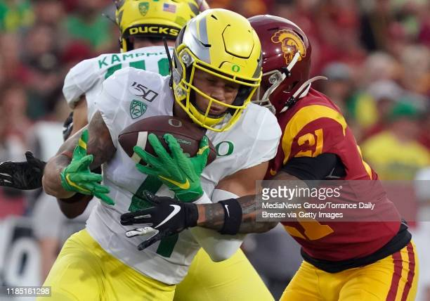 Trojans safety Isaiah PolaMao tackles Oregon Ducks wide receiver Mycah Pittman after a reception at the Los Angeles Memorial Coliseum on Saturday Nov...