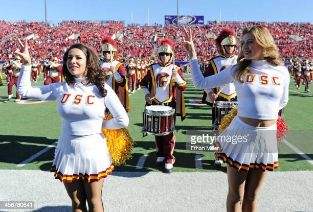 Trojans Song Girls Alexa Trujillo and Perry Mattfeld perform with the USC marching band before the team's game against the Fresno State Bulldogs in...