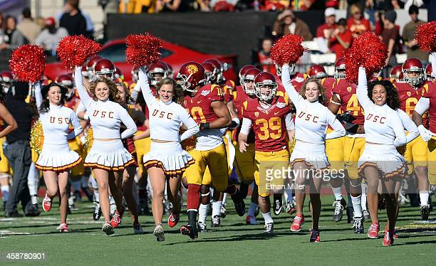 Trojans Song Girls run onto the field with the team before their game against the Fresno State Bulldogs in the Royal Purple Las Vegas Bowl at Sam...