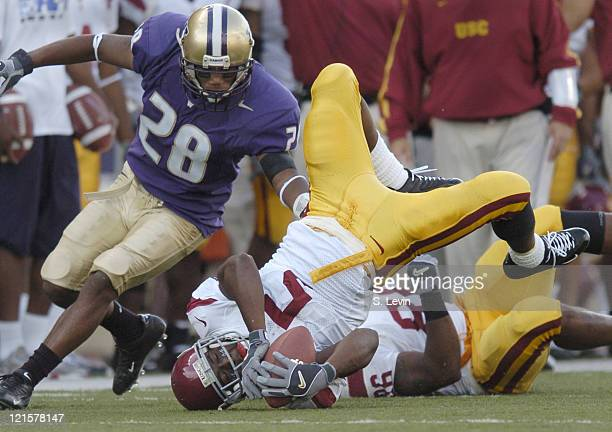 Trojans Steve Smith is upended after a reception during the game between the USC Trojans and the University of Washington Huskies at Husky Stadium in...