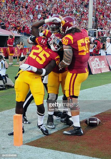Trojans tailback Ronald Jones II reacts in the end zone with his teammates after scoring a touchdown in the first quarter of a game against the...
