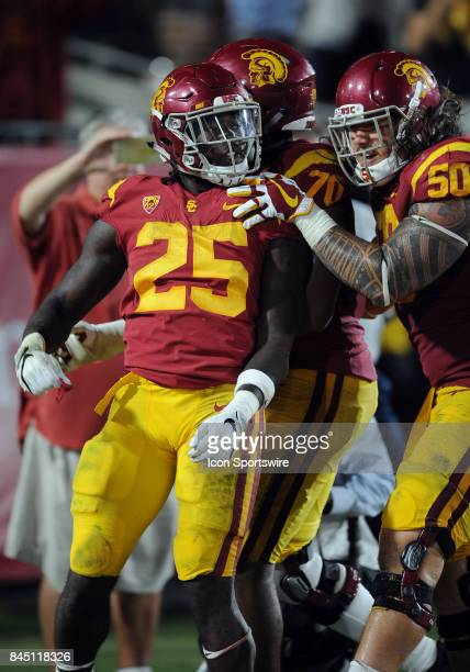 Trojans tailback Ronald Jones II reacts in the end zone with his teammates after scoring a touchdown in the fourth quarter of a game against the...