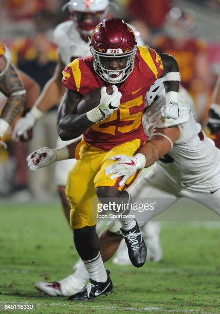 Trojans tailback Ronald Jones II tries to get away from Stanford Cardinal line backer Mike Tyler during the fourth quarter of a game played on...