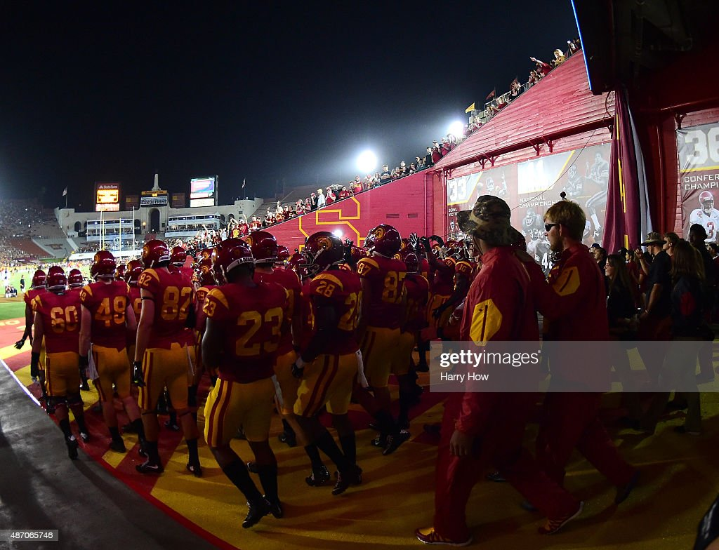 Trojans team take to the field before the start of the opening season game against the Arkansas State Red Wolves at Los Angeles Coliseum on September 5, 2015 in Los Angeles, California.