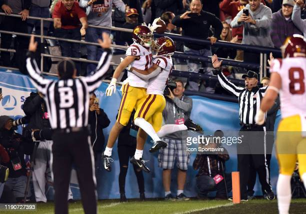 Trojans wide receiver Drake London celebrates with USC Trojans wide receiver AmonRa St Brown after scoring a touchdown during the Holiday Bowl game...