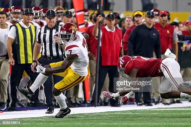 Trojans wide receiver Steven Mitchell Jr turns the corner around Alabama Crimson Tide defensive back Eddie Jackson during the NCAA Advocare Classic...