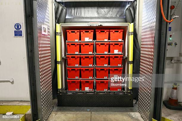 A trolley load of completed customer order crates sits in a delivery vehicle at the Ocado Group Plc distribution centre in Dordon UK on Friday Dec 16...