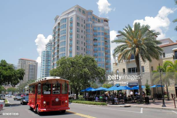 A trolley passing Parkshore Grill