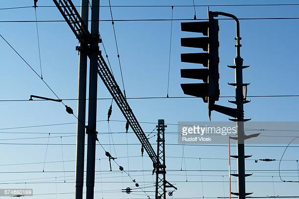 trolley wires and semaphore on a railway station - semaphore stock pictures, royalty-free photos & images