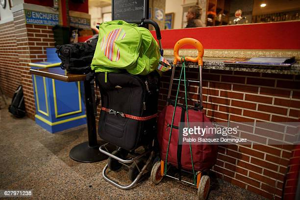 Trolleys are parked at the entrance of Robin Hood restaurant while homeless people have free dinner inside on December 5 2016 in Madrid Spain...