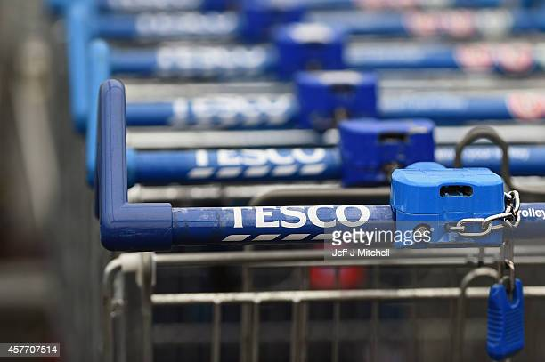 Trolleys are placed outside a Tesco supermarket on October 23 2014 in Glasgow ScotlandTesco one of Britains biggest supermarkets has announced a 919%...