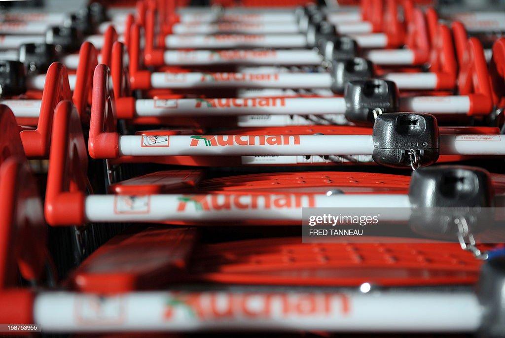 Trolleys are seen outside a supermarket Auchan on December 27, 2012 in Saint-Sebastien-sur-Loire, western France.