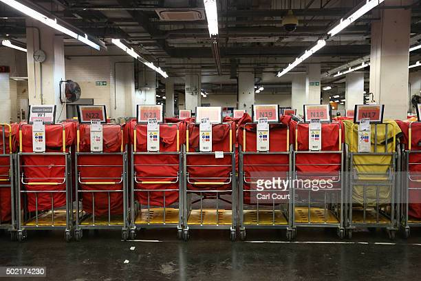 Trolleys await sorting at Royal Mail's Mount Pleasant Mail Centre on December 21 2015 in London England This week is expected to be the busiest of...