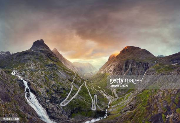 trollstigen, norway, sunset over the trollstigen valley road - tal stock-fotos und bilder