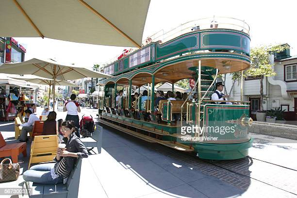 A trolly runs through The Grove shopping center an outdoor mall at 3rd and Fairfax in Los Angeles