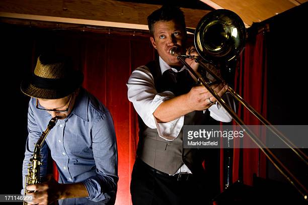 Trombone and Saxophone Player At Bar