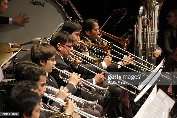 A trombone group in a heart felt performance A full decade away from being a century old the Manila Symphony Orchestra turns to Russian Romanticism...
