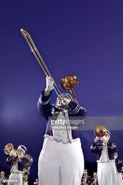trombone player in marching band - marching band stock pictures, royalty-free photos & images
