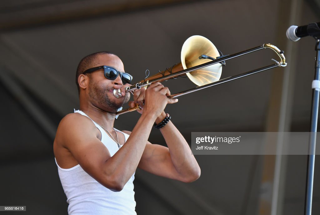 Trombone Shorty & Orleans Avenue perform onstage during Day 7 of the 2018 New Orleans Jazz & Heritage Festival at Fair Grounds Race Course on May 6, 2018 in New Orleans, Louisiana.
