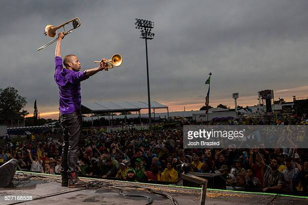 Trombone Shorty performs at the New Orleans Jazz Heritage Festival at Fair Grounds Race Course on May 1 2016 in New Orleans Louisiana
