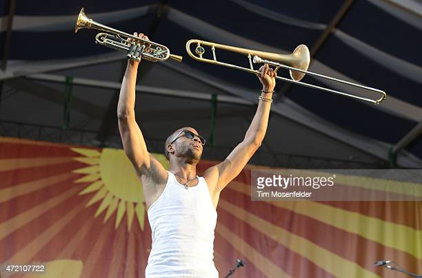 Trombone Shorty performs during the 2015 New Orleans Jazz Heritage Festival at Fair Grounds Race Course on May 3 2015 in New Orleans Louisiana