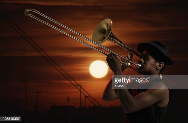Trombonist at sunset
