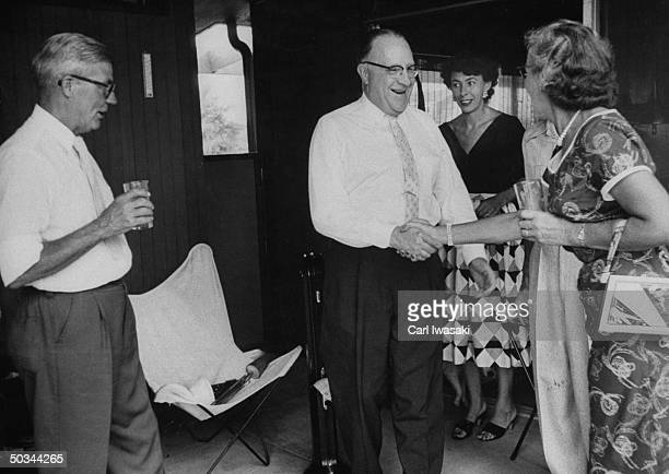 Trombonist DeWitt Peters member of Holly Moyer's Canon Park Jazz Band greeting wife of Banjoist Mrs Emil Christenen