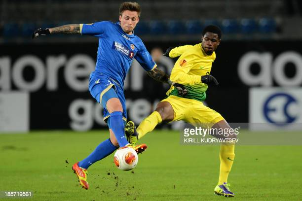 Tromso IL's forward Steffen Nystrom vies with Anji Makhachkala's defender Ayodele Adeleye during their UEFA Europa League Group K football match in...