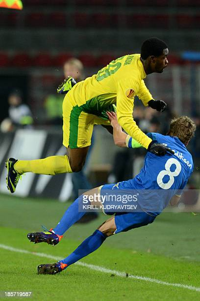 Tromso IL's mildfielder Thomas Bendiksen vies with Anji Makhachkala's defender Ayodele Adeleye during their UEFA Europa League Group K football match...