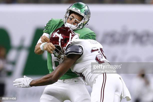 Tron Folsom of the Troy Trojans hits Mason Fine of the North Texas Mean Green in the first half during the RL Carriers New Orleans Bowl at the...