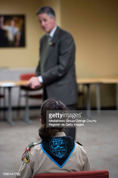 Troop leader Dea Del Rosario listens to Rancho Santa Margarita Mayor Pro Tem Bradley McGirr during a ceremony to submit an application for the...