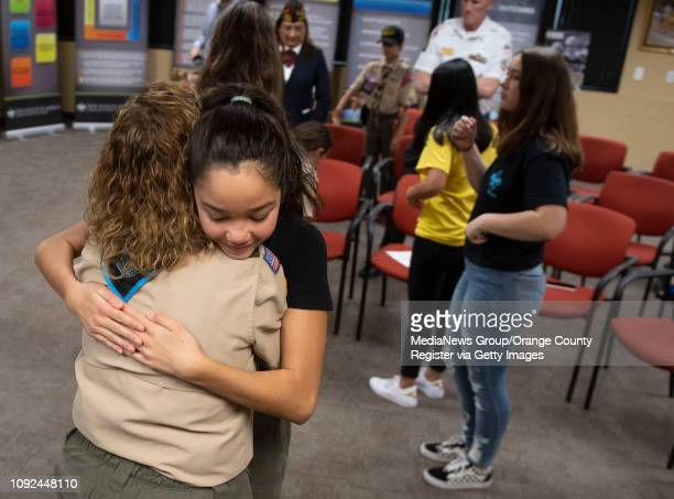 Troop leader Monique Chrisope hugs founding member Sophia Del Rosario after a ceremony to submit an application for the county's first allgirl Boy...