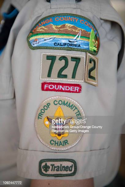 Troop leader Monique Chrisope improvised a velcro'ed number two on her Troop uniform before a ceremony to submit an application for the county's...