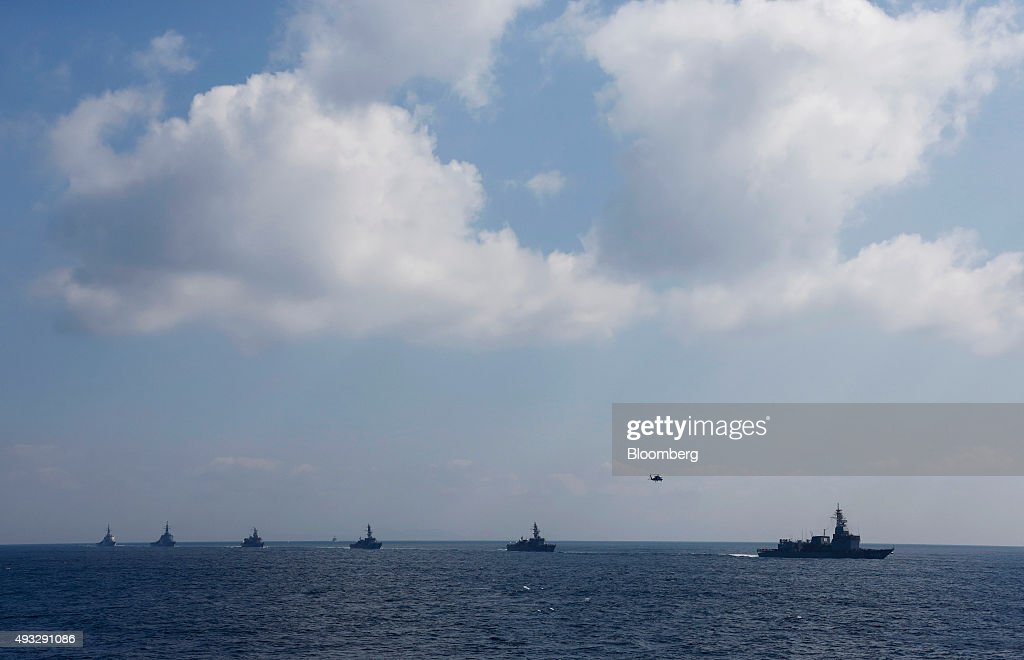 A troop of Japan's Maritime Self-Defense Force vessels sail during a fleet review at Sagami Bay, off Yokosuka, Kanagawa Prefecture, Japan, on Sunday, Oct. 18, 2015. Prime Minister Shinzo Abeâs public approval ratings declined after the passage of legislation allowing Japan to send troops to fight in overseas conflicts for the first time since World War II. Photographer: Tomohiro Ohsumi/Bloomberg via Getty Images