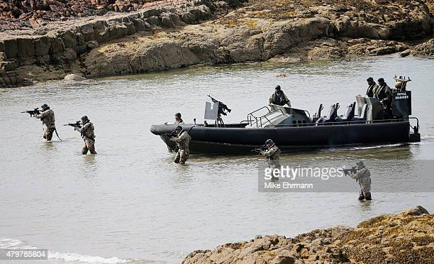 A troop of Royal Marines from the 43 Commando approach a beach via the Firth of Forth on an ORC to deliver the Scottish Open trophy for 'safe...