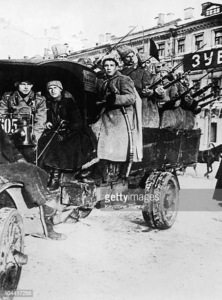 A troop of soldiers rallied to the revolutionary cause on a truck in Petrograd in February 1917