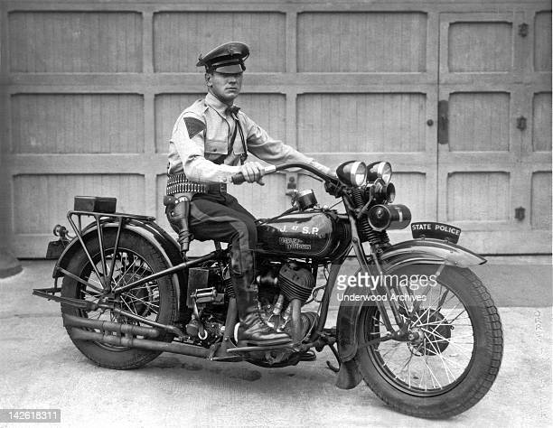 Trooper Haley of the New Jersey State Police poses on his Harley Davidson motorcycle New Jersey 1930