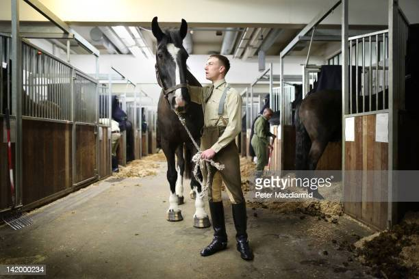 Trooper Lee Holland of The Household Cavalry Mounted Regiment stands with his horse Goliath at Hyde Park Barracks on March 28, 2012 in London,...
