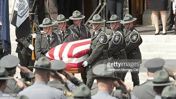 Trooper pall bearers carry the casket of slain State Trooper Bryon Dickson outside Saint Peter's Cathedral in Scranton Pa at the conclusion of the...