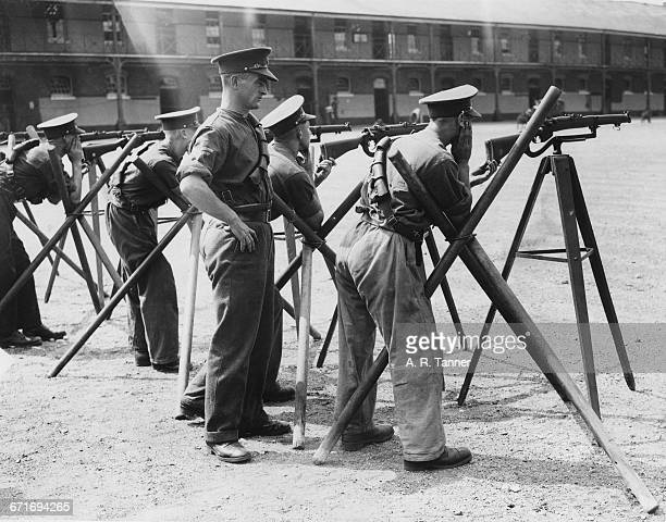 Troopers of the 4th Queen's Own Hussars are given drill instruction on how to use the Short Magazine Lee–Enfield Mk III .303 bolt action rifle...