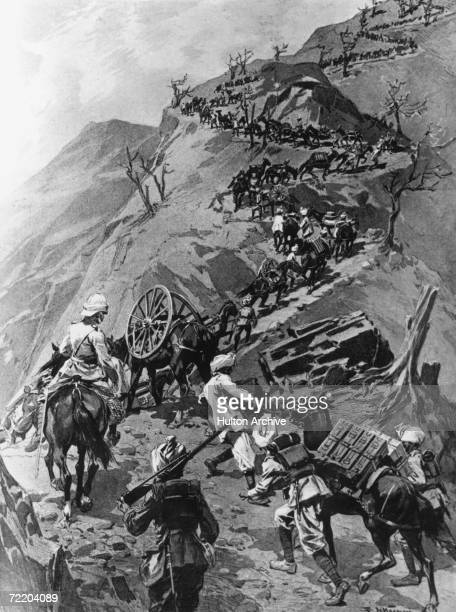 Troops and pack animals climb a steep mountain pass near Lingtu on their way to Tibet during the expedition led by British Army officer and explorer...
