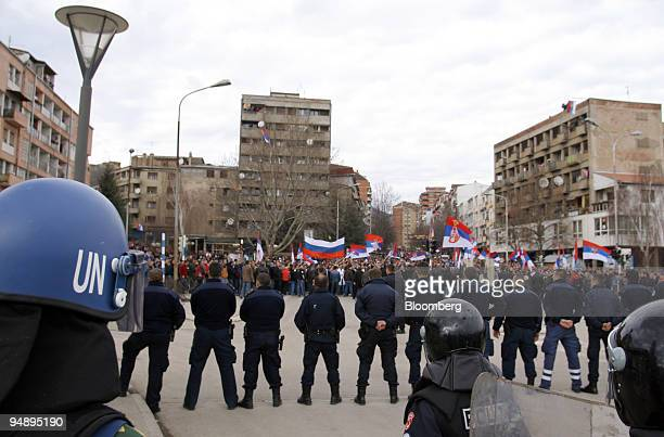 NATO troops and police form a line by the Mitovica Bridge to hold back Serb protestors in Mitrovica Serbia on Friday Feb 22 2008 Kosovar police and...