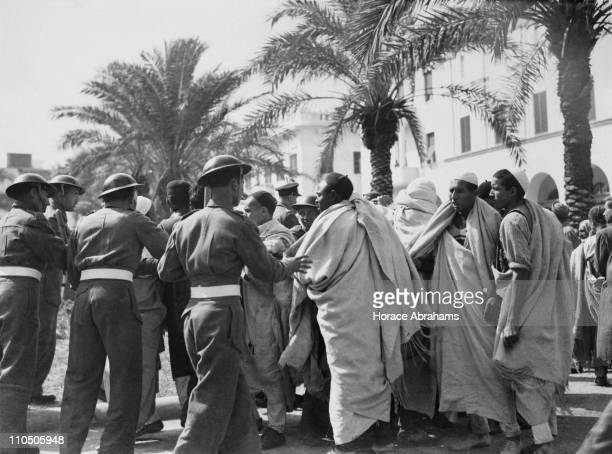 Troops approach protesters in Castle Square Tripoli Libya during the riots which followed the country's first election February 1952 The...
