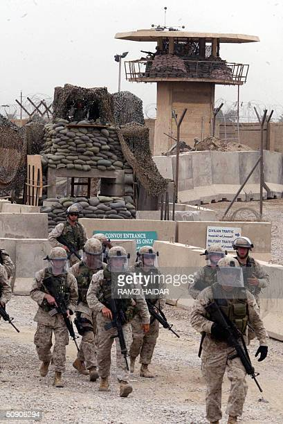 US troops are seen outside the Abu Ghraib prison west of Baghdad 28 May 2004 as some 600 Iraqi prisoners are released US forces released a new wave...