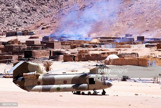 Troops arrive by helicopter to try to recapture territory lost to Chad After nearly two decades of effort Colonel Moammar Gadhafi's imperial...