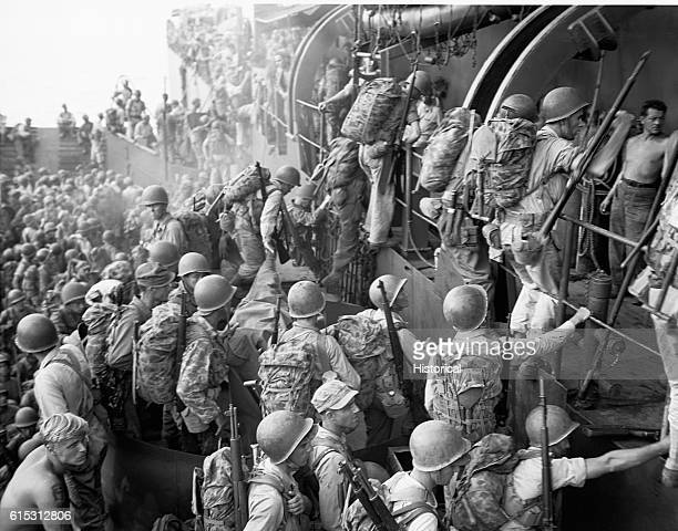 US troops board an LST for the invasion of Morotai during World War II   Location Morotai Indonesia
