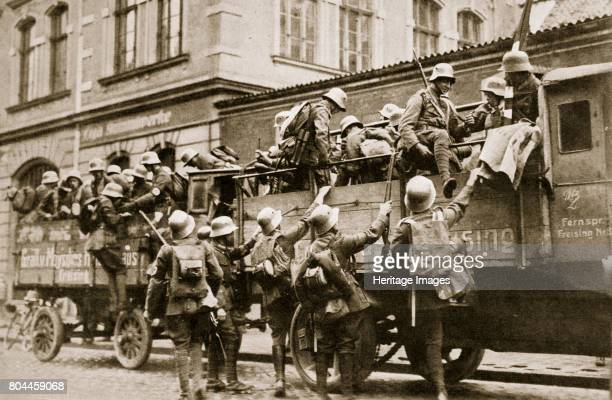 SA troops climbing into trucks Germany c1926 Founded in c1919 the Sturmabteilung was the paramilitary wing of the Nazi party Its members were known...