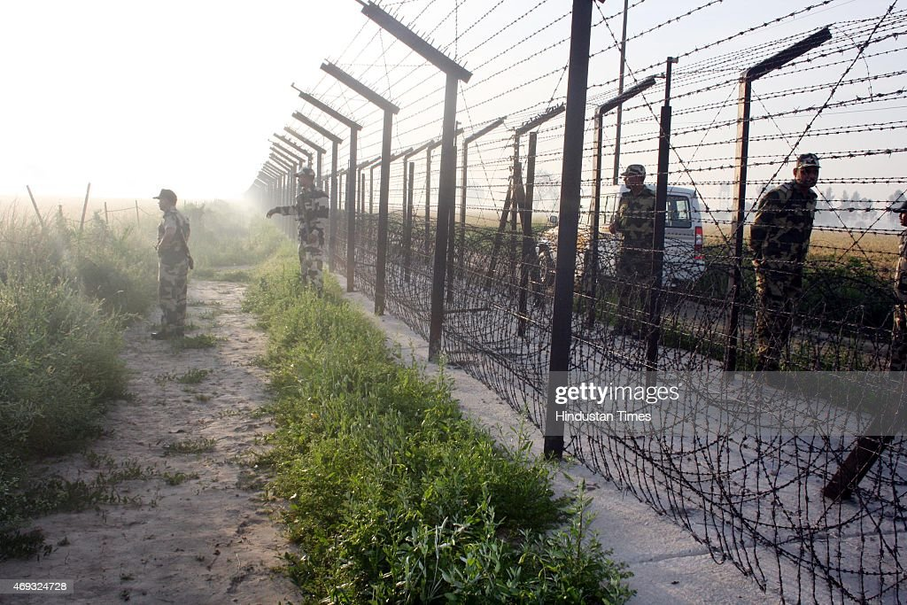BSF troops conducting the search operation after their vehicle was attacked by Pakistani smugglers on April 11 2015 in Amritsar India Three BSF...